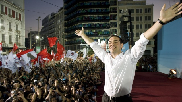 Syriza Party leader Alexis Tsipras greets supporters at a party rally in Athens. The leftist party came second in the elections last month and could win a revote on Sunday.